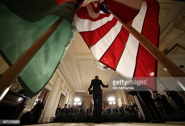 President Barack Obama answers a question while holding a joint press conference with President of Afghanistan Ashraf Ghani in the East Room of the...