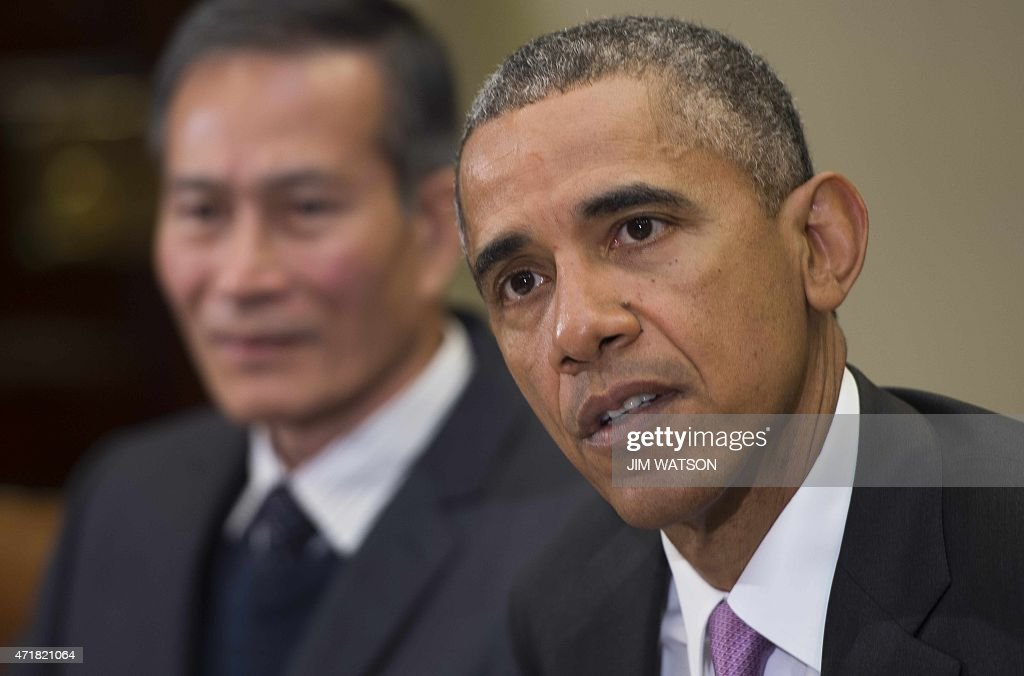US President Barack Obama (C) answers questions about events in Baltimore at the White House in Washington, DC, May 1, 2015. Obama said Friday it was 'absolutely vital' that the truth come out about the death of an African American man in Baltimore from injuries sustained while in police custody, after six officers were charged.
