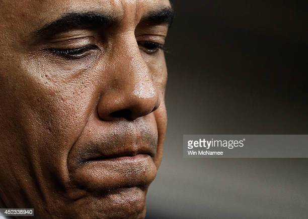 S President Barack Obama answers questions after delivering a statement on the Malaysia Airlines crash over eastern Ukraine in the Brady Press...