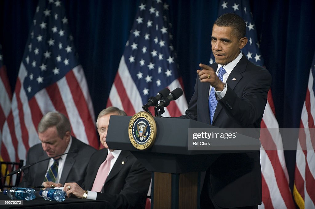 President Barack Obama answers questions from Senate Democrats during their retreat at the Newseum in Washington on Wednesday, Feb. 3, 2010. To the left are Sen. Richard Durbin, D-Ill., and Senate Majority Leader Harry Reid, D-Nev.