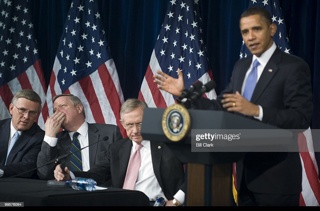 President Barack Obama answers questions from Senate Democrats during their retreat at the Newseum in Washington on Wednesday, Feb. 3, 2010. To the left are Sen. Byron Dorgan, D-N. Dak., Sen. Richard Durbin, D-Ill., and Senate Majority Leader Harry Reid, D-Nev.