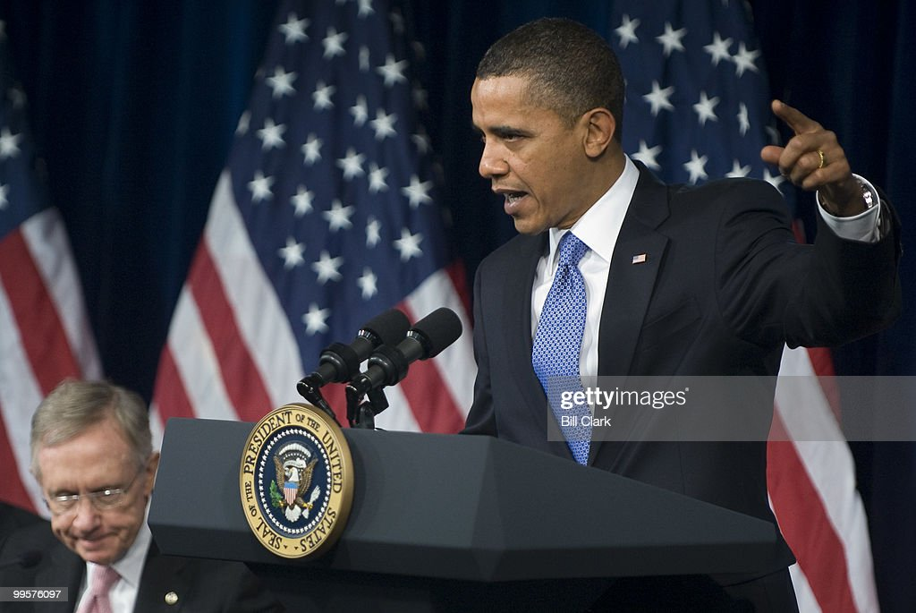 President Barack Obama answers questions from Senate Democrats during their retreat at the Newseum in Washington on Wednesday, Feb. 3, 2010. To the left is Senate Majority Leader Harry Reid, D-Nev.