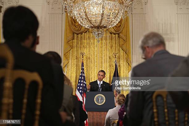 S President Barack Obama answers reporters' questions during a news conference in the East Room of the White House August 9 2013 in Washington DC...