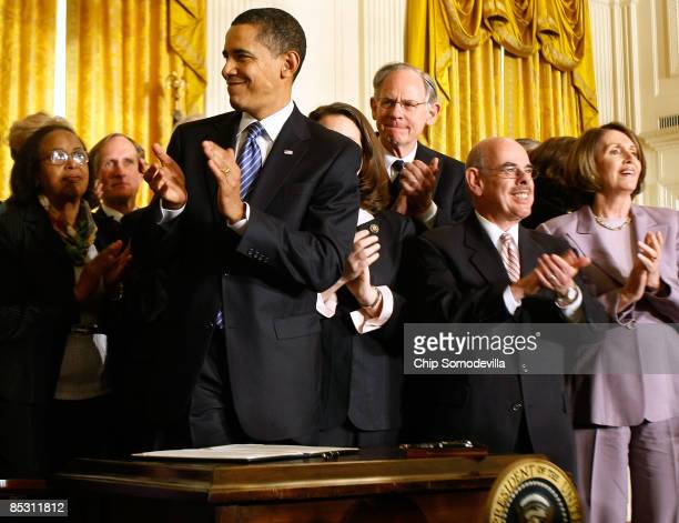 S President Barack Obama applauds after signing an Executive Order reversing the US government�s ban on funding stemcell research during a ceremony...