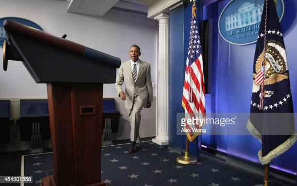 President Barack Obama approaches the podium to make a statement at the James Brady Press Briefing Room of the White House August 28, 2014 in...