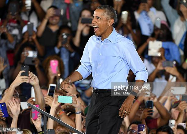 S President Barack Obama arrives at a campaign rally for Democratic presidential nominee Hillary Clinton at Cheyenne High School on October 23 2016...