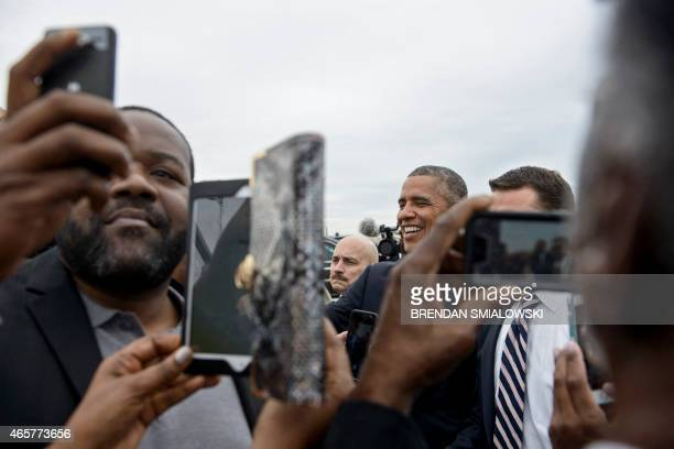 US President Barack Obama arrives at HartsfieldJackson Atlanta International Airport March 10 2015 in Atlanta Georgia AFP PHOTO/BRENDAN SMIALOWSKI