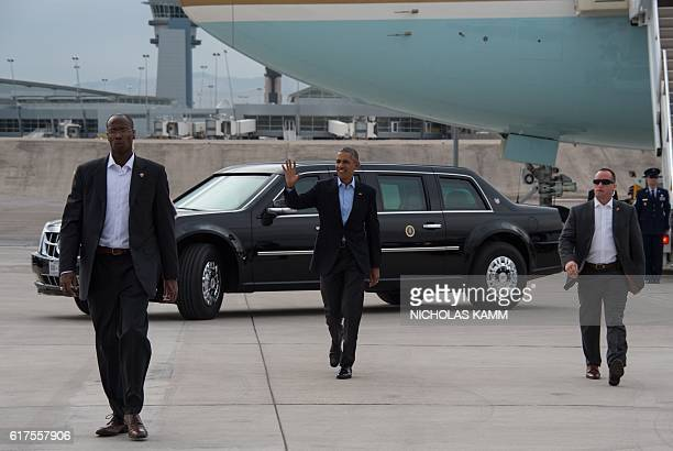 US President Barack Obama arrives at McCarran International Airport in Las Vegas on October 23 2016 to attend a campaign event for Democratic...