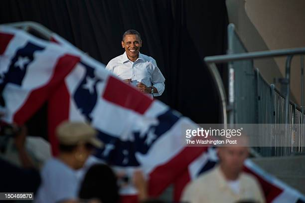 AUGUST 14 President Barack Obama arrives during a campaign stop at RiverLoop Amphitheatre Waterloo Center for the Arts in Waterloo Iowa on Tuesday...