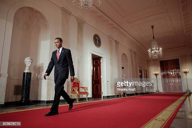 President Barack Obama arrives for a news conference in the East Room of the White House in Washington