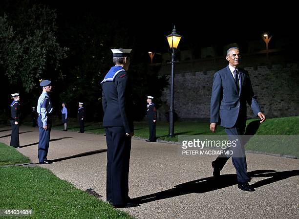 US President Barack Obama arrives for the NATO Summit dinner at Cardiff Castle on September 4 2014 in Cardiff south Wales The NATO summit billed as...
