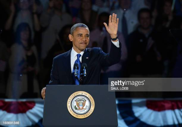 US President Barack Obama arriveS on stage after winning the 2012 US presidential election November 7 2012 in Chicago Illinois Obama swept to...