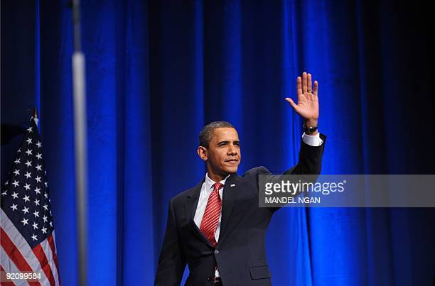 US President Barack Obama arrives on stage to speak at a fundraiser for the Democratic National Committee at the Hammerstein October 20 2009 in New...