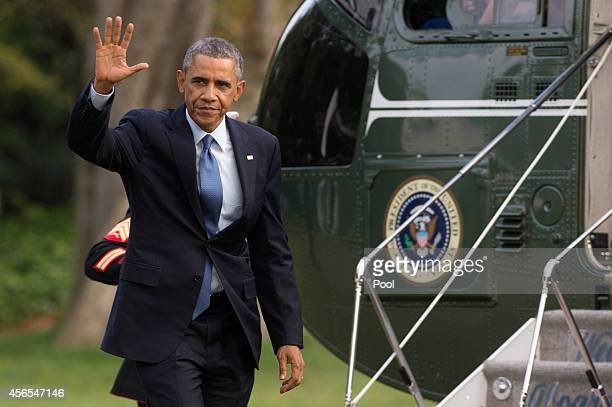 S President Barack Obama arrives on the South Lawn of the White House by Marine One October 2 2014 in Washington DC The president was returning from...