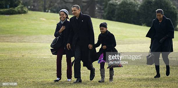 President Barack Obama arrives on the South Lawn of the White House in Washington, DC, with First Lady Michelle Obama and his daughter Sasha and...