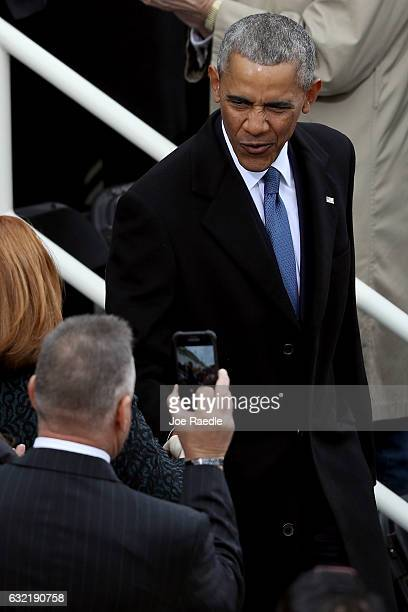 President Barack Obama arrives on the West Front of the US Capitol on January 20 2017 in Washington DC In today's inauguration ceremony Donald J...