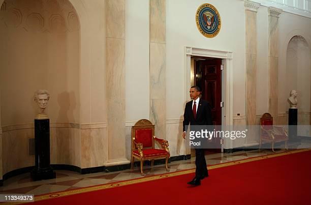 President Barack Obama arrives through the Cross Hall to announce Al-qaida terror leader Osama bin Laden is dead in the East Room of the White House...