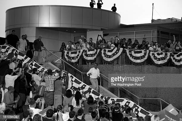 AUGUST 14 President Barack Obama arrives to applause and chants of Four More Years during a campaign stop at RiverLoop Amphitheatre Waterloo Center...