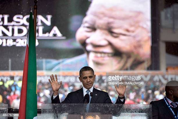 US President Barack Obama arrives to deliver a speech during the memorial service for late South African President Nelson Mandela at Soccer City...