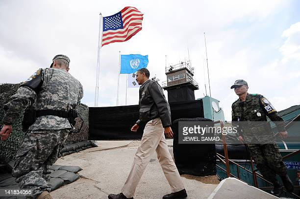 US President Barack Obama arrives to look towards North Korea from from Observation Post Ouellette during a visit to the Joint Security Area of the...