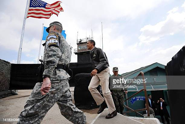 US President Barack Obama arrives to look towards North Korea from Observation Post Ouellette during a visit to the Joint Security Area of the...