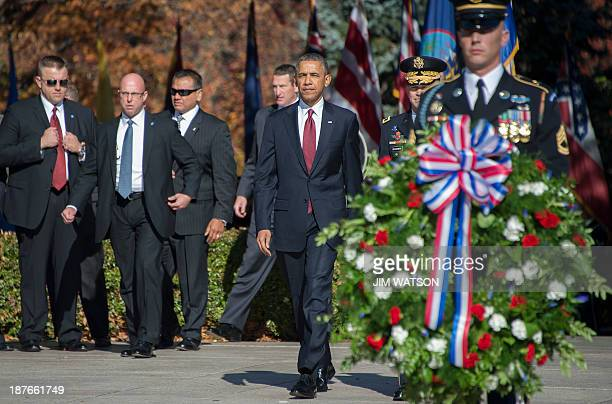 US President Barack Obama arrives to place a wreath at the Tomb of the Unknown Soldier during a Veteran's Day ceremony at Arlington National Cemetery...