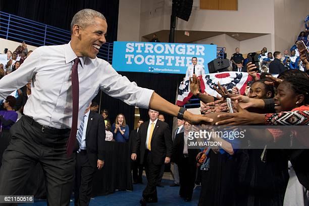 US President Barack Obama arrives to speak at Fayetteville State University in Fayetteville North Carolina November 4 during a Hillary for America...