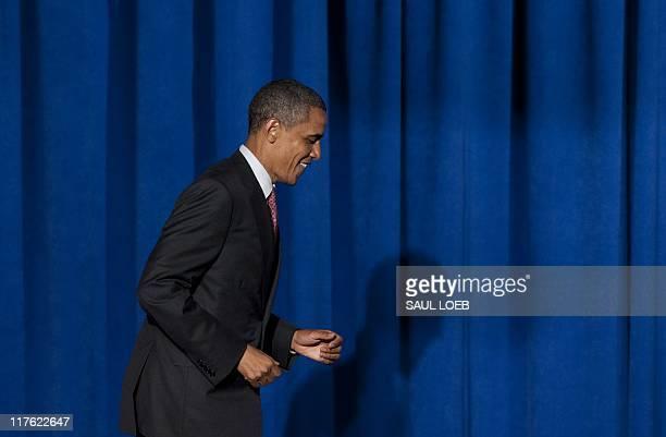 US President Barack Obama arrives to speak at the Democratic National Committee's Lesbian Gay Bisexual Transgender Leadership Gala in New York June...