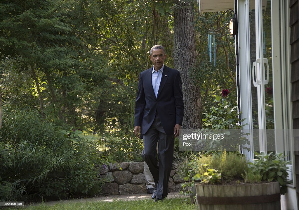 President Barack Obama arrives to speak briefly at a news conference on Iraq August 11, 2014 in Chilmark on Martha's Vineyard, Massachusetts. The president, vacationing on the island, called for the formation of a new government in Iraq and said the U.S. had successfully flown military sorties against Islamist extremists and had conducted humanitarian relief missions, according to published reports.