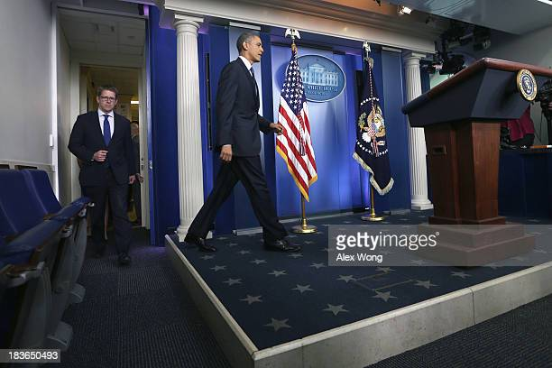 President Barack Obama arrives to speak during a press conference with Press Secretary Jay Carney in the Brady Press Briefing Room of the White House...