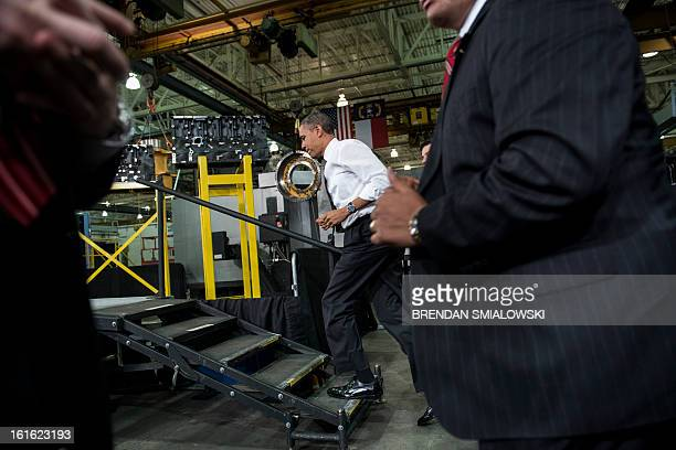 US President Barack Obama arrives to speak during an event at the Linamar factory February 13 2013 in Arden North Carolina Obama toured the factory...