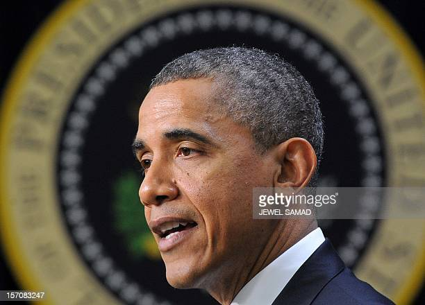 US President Barack Obama arrives to speak during an event with middle class Americans who would see their taxes go up if Congress fails to act to...
