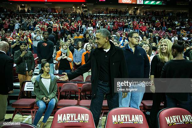 President Barack Obama arrives to take his seat for a men's NCCA basketball game between University of Maryland and Oregon State University, November...