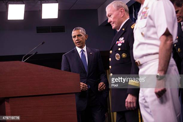 US President Barack Obama arrives to the podium to deliver remarks after meeting with members of his national security team concerning ISIS at the...