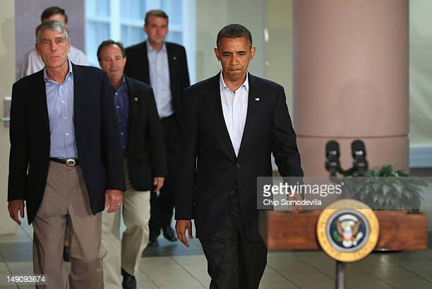 US President Barack Obama arrives with members of the Colorado Congressional delegation during a visit to the University of Colorado Hospital July 22...