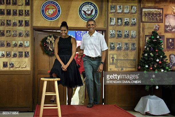 US President Barack Obama arrives with US first lady Michelle Obama to address members of the US Marines their loved ones and others to celebrate the...