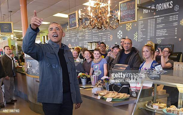 US President Barack Obama asks if staff and press want anything before ordering at the Snow City Cafe on September 1 2015 in Anchorage Alaska Obama...