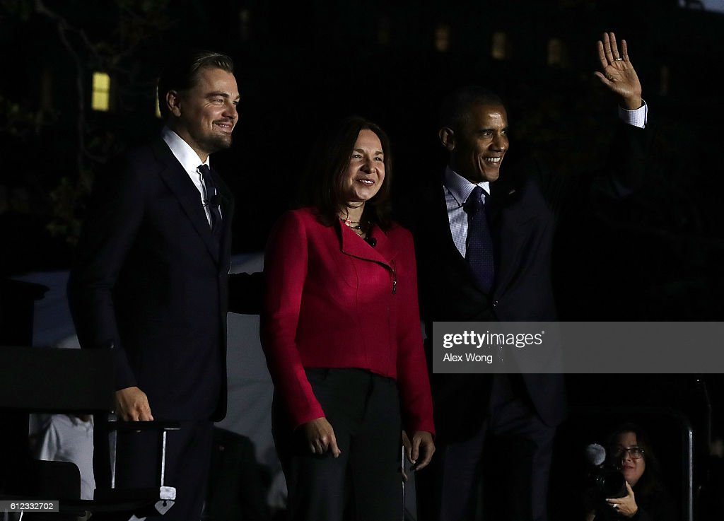 U.S. President Barack Obama, atmospheric scientist Katharine Hayhoe, and actor Leonardo DiCaprio arrive on the stage to participate in a conversation during the South by South Lawn, a White House festival of ideas, art, and action, October 3, 2016 at the South Lawn of the White House in Washington, DC. The White House hosts the event to call on Americans 'to discover their own way to make a positive difference in our country.'
