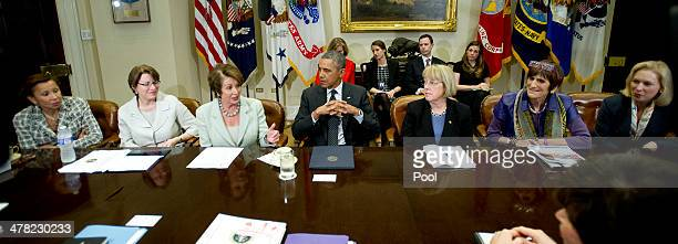 S President Barack Obama attends a meeting with women lawmakers including Rep Nydia Velazquez Sen Amy Klobuchar House Minority Leader Nancy Pelosi...