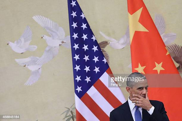 S President Barack Obama attends a press conference with Chinese President Xi Jinping at the Great Hall of People on November 12 2014 in Beijing...