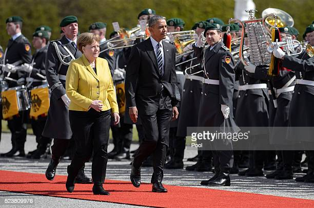 S President Barack Obama attends a welcoming ceremony at Herrenhausen Palace accompanied by German Chancellor Angela Merkel on Obama's first day of a...