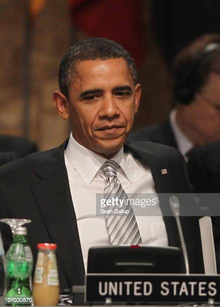 S President Barack Obama attends the Afghanistan roundtable meeting at the 2010 NATO Summit on November 20 2010 in Lisbon Portugal The twoday summit...