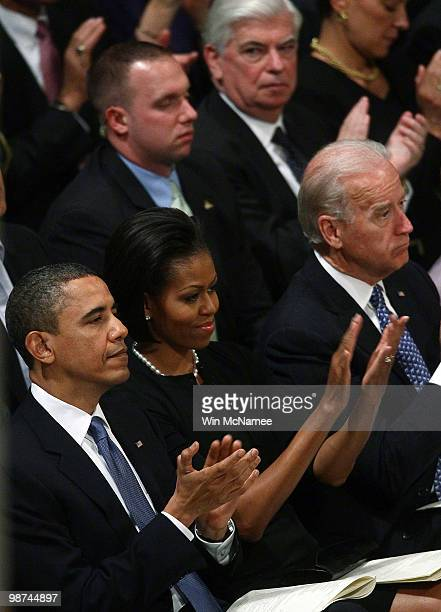 US President Barack Obama attends the funeral service for civil rights leader Dorothy Height with first lady Michelle Obama and US Vice President Joe...