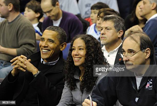 US President Barack Obama attends the game between the Duke Blue Devils and Georgetown Hoyas on January 30 2010 at the Verizon Center in Washington...