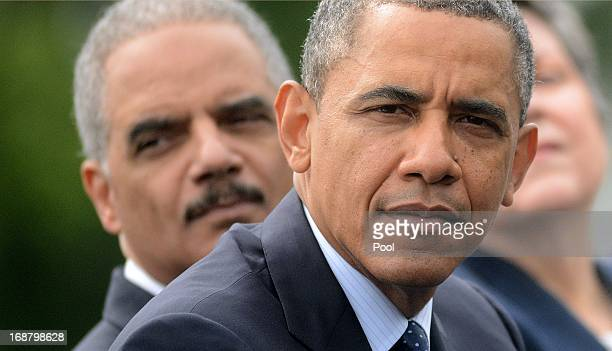 US President Barack Obama Attorney General Eric Holder and Secretary of Homeland Security Janet Napolitano look on during the 32nd annual National...