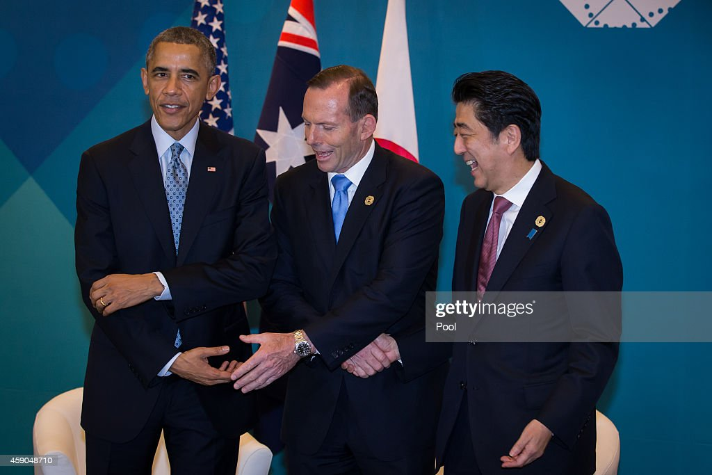 U.S. President Barack Obama, Australian Prime Minister Tony Abbott, and Japan's Prime Minister Shinzo Abe meet during a trilateral meeting at the G20 Summit on November 16, 2014 in Brisbane, Australia. World leaders have gathered in Brisbane for the annual G20 Summit and are expected to discuss economic growth, free trade and climate change as well as pressing issues including the situation in Ukraine and the Ebola crisis.