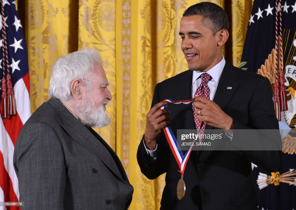 US President Barack Obama awards Solomon Golomb from University of Southern California with the National Medal of Science, the highest honors bestowed by the US upon scientists, engineers, and inventors, during a ceremony in the East Room at the White House in Washington, DC, on February 1, 2013. AFP PHOTO/Jewel Samad