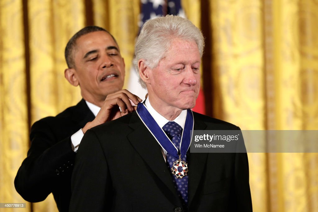 U.S. President Barack Obama awards the Presidential Medal of Freedom to former U.S. President Bill Clinton in the East Room at the White House on November 20, 2013 in Washington, DC. The Presidential Medal of Freedom is the nation's highest civilian honor, presented to individuals who have made meritorious contributions to the security or national interests of the United States, to world peace, or to cultural or other significant public or private endeavors.