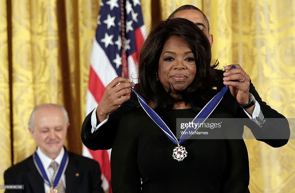 U.S. President Barack Obama awards the Presidential Medal of Freedom to Oprah Winfrey in the East Room at the White House on November 20, 2013 in Washington, DC. The Presidential Medal of Freedom is the nation's highest civilian honor, presented to individuals who have made meritorious contributions to the security or national interests of the United States, to world peace, or to cultural or other significant public or private endeavors. Also pictured is Mario Molina (L).