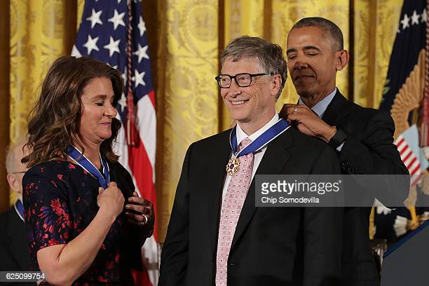 S President Barack Obama awards the Presidential Medal of Freedom to Microsoft founder Bill Gates and his wife Melinda Gates who have donated...